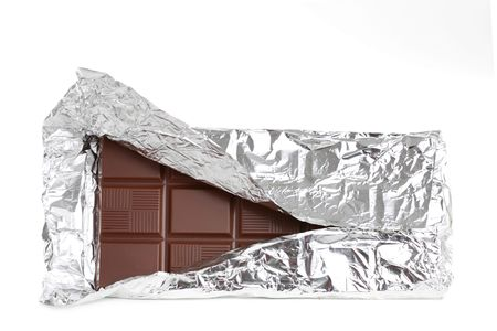 solid: big milk chocolate bar wrapped in aluminium paper, isolated on white