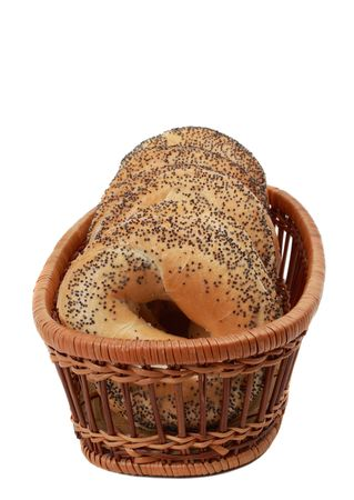 poppy seeds bagels in a basket isolated on white Stock Photo - 4627787