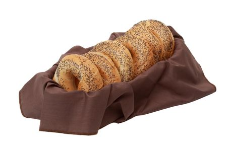 poppy seeds bagels in a basket with brown fabric napkin Stock Photo - 4627790