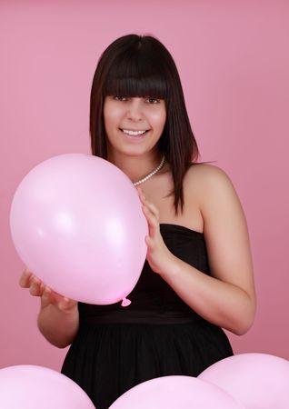 cute caucasian girl holding a pink balloon Stock Photo - 4690236