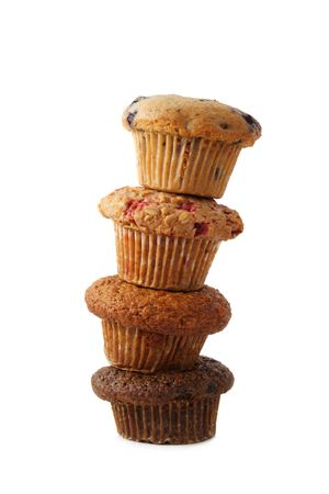 collation: four stacked muffin isolated on white background