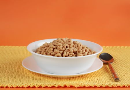 healthy cereal in a white bowl, yellow tablecloth Stock Photo - 5210908