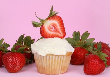 cupcake with white icing and strawberries Stock Photo