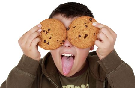 teen boy playing with cookies, isolated on white Stock Photo - 5501510