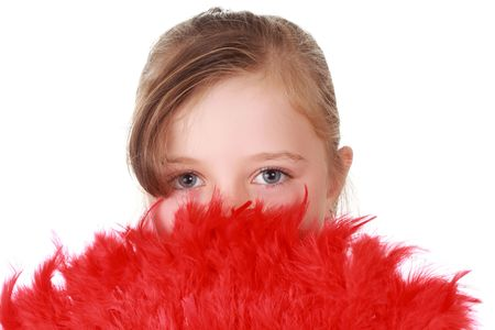 cute little blond girl hiding behind red feathers Stock Photo - 5794838