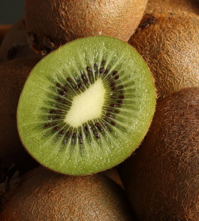 closeup on sliced kiwi fruit over whole fruit Stock Photo - 9992089