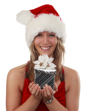 beautiful young woman holding a silver Christmas gift, isolated on white Stock Photo - 10613251