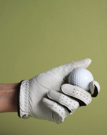 female hand with white glove holding a golf ball Stock Photo - 11888307
