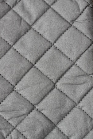 fabric textures: closeup on grey quilted insulated fabric Stock Photo
