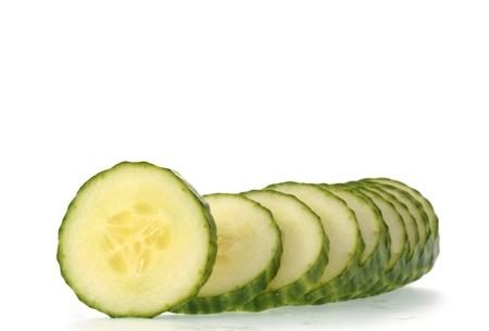 english cucumber: slices of english cucumber isolated on white background