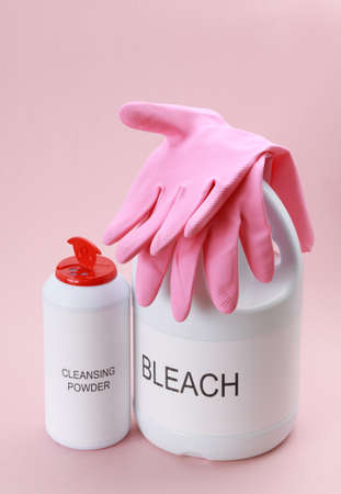 cleanser: bottle of domestic cleanser with pink gloves