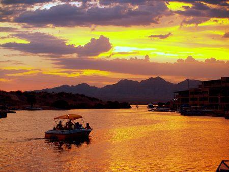Boat at sunset photo