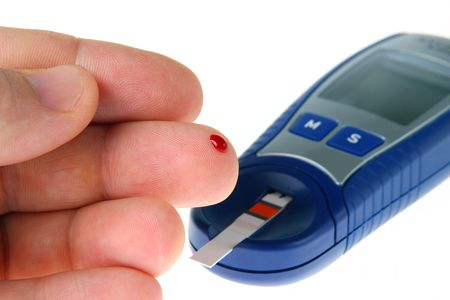 poking: Diabetic is doing a glucose level finger blood test