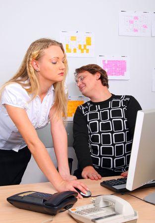 subordinated: The boss looks at beautiful secretary