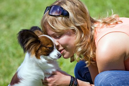 Papillon: Happy young woman and her papillon dog