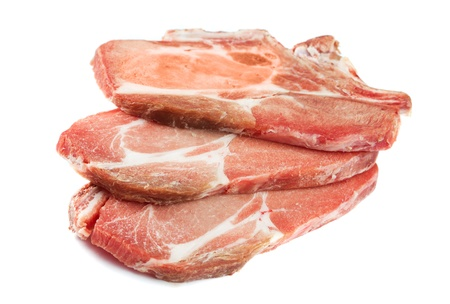 Frozen meat: uncooked pork chops close up