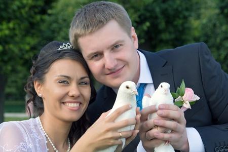 Portrait young happy bride and groom outdoor photo