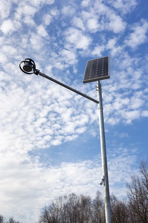 standalone: Stand-alone street light with solar battery on sky background. Renewable Energy