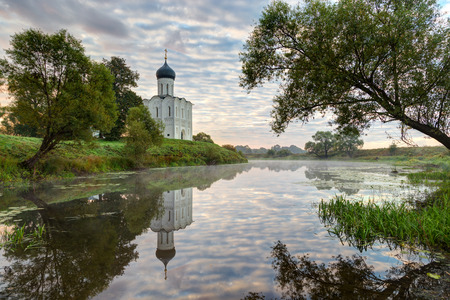 nerl river: Church of Intercession of Holy Virgin on the Nerl River early in morning. Built in 12th century. Bogolyubovo, Vladimir region, Golden Ring of Russia