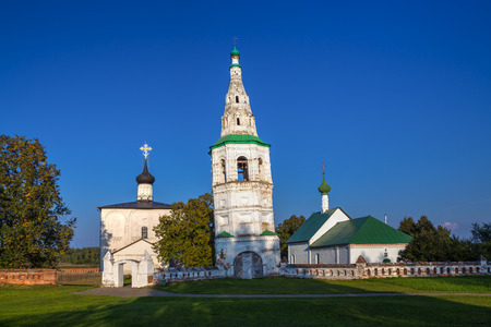boris: Leaning bell tower and two churches. Ancient architectural complex in the village of Kideksha. Golden Ring of Russia