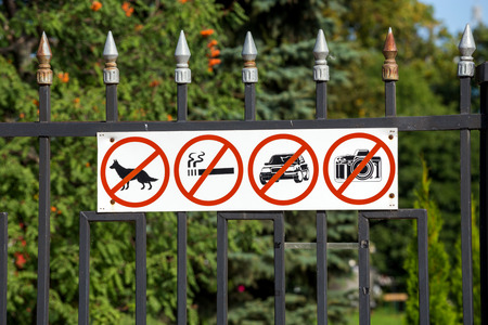 prohibiting: TAMBOV, RUSSIA - SEPTEMBER 13, 2014: Prohibiting signs on the fence Kazan Monastery Stock Photo
