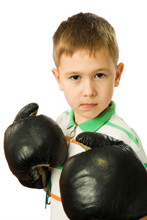 anger kid: The boy in boxing gloves on a white background