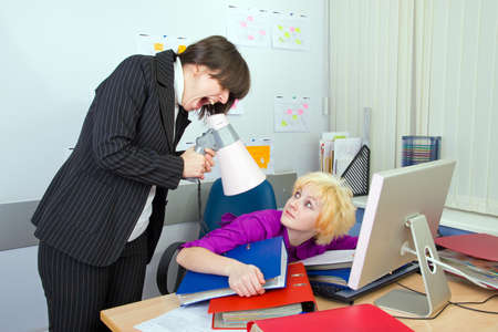 subordinated: Boss shouts in a megaphone at employee of office Stock Photo