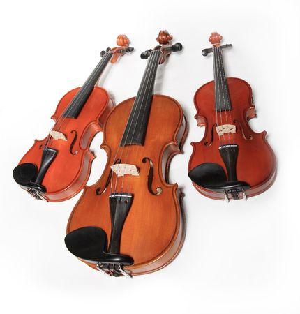 scores: Three violins on white background. The Hard light. Stock Photo
