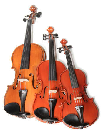 quintet: Three violins on white background. The Hard light. Stock Photo