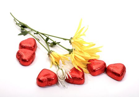 sweetmeats: Flowerses and sweetmeats  on white background Stock Photo