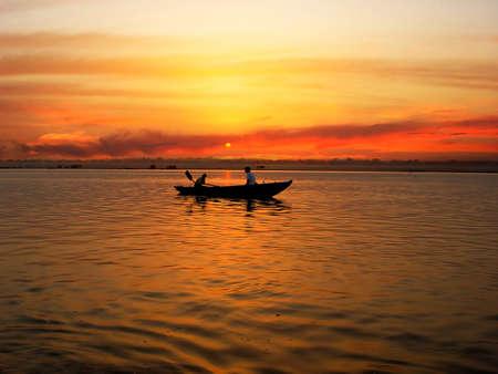 serene: Sunrize ture on the Ganga river, Varanasi, India.                                Stock Photo