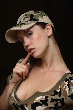 military uniform: Portrait posing Young of beautiful woman in military uniform