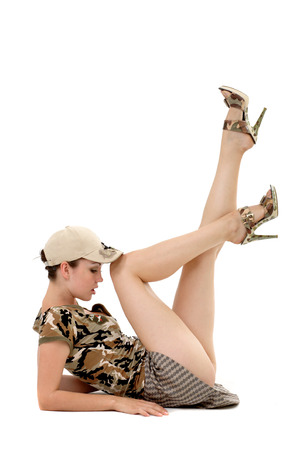 pin-up image of sexy lovely brunet in military form photo