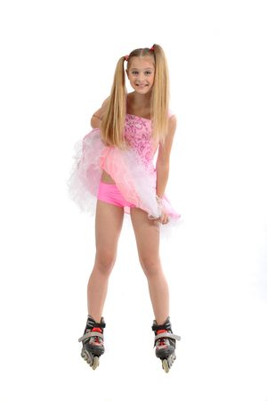 rollerskates: pretty young sweet girl with roller skates Stock Photo