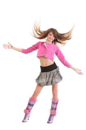 legs open: Happy girl with flying hair, wearing pink mini cardigan with short skirt and high heel boots