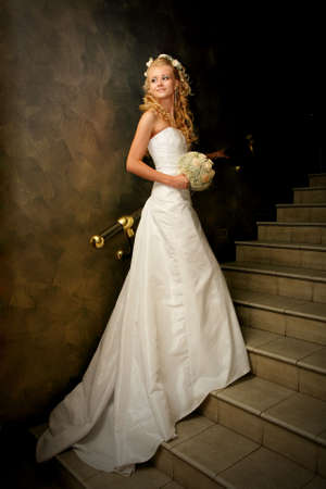 wind blown hair: Beautiful smiling caucasian bride