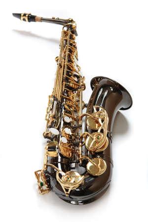 vibran: El saxof�n de color de chocolate con oro. Instrumento musical.  Foto de archivo