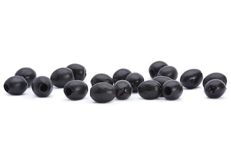 pitted: Marinated black pitted olive closeup isolated on white background Stock Photo