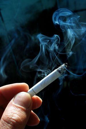 smoking: A smoking cigarette  Stock Photo