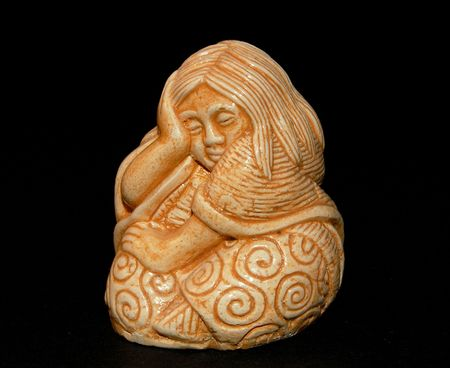 grieved: Stone figure of the sitting girl