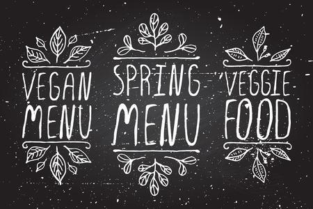 menu: Hand-sketched typographic elements on chalkboard background. Vegan menu. Spring menu. Veggie food. Restaurant labels. Suitable for ads, signboards, menu and web banner designs Illustration