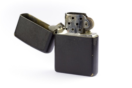 Old metal lighter isolated on white background photo