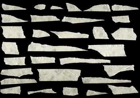 tear duct: Strips of masking tape isolated on black background