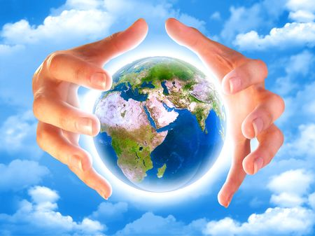 Hands and lighting earth planet in the sky with clouds Stock Photo - 1356613
