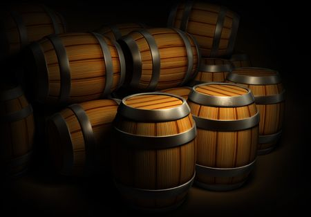 wooden barrels for wine and beer storage in dark cellar photo