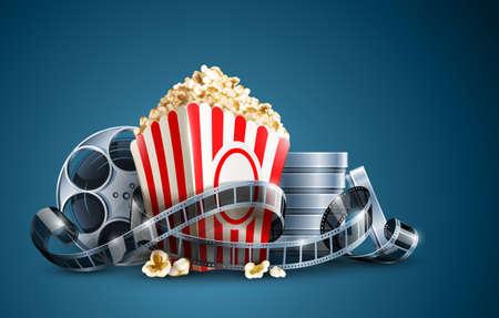 popcorn: bobina di pellicola di film e popcorn