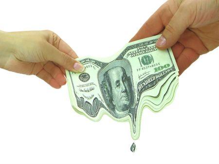 Couple sharing melting money, money melting in hands Stock Photo