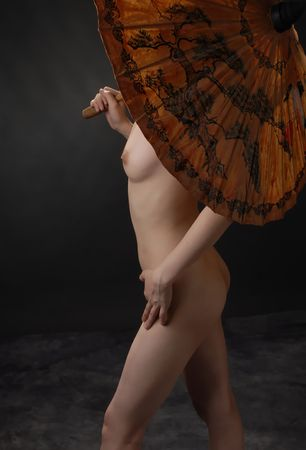 Female and erotic body cover with an oriental umbrella Stock Photo