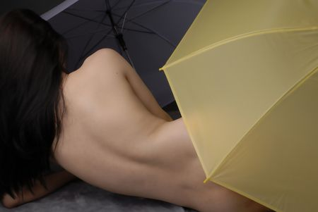 Female and erotic body cover with umbrellas