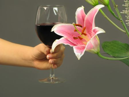 Glass of red wine and a flower waiting for a special person